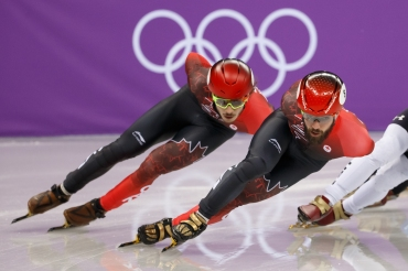 Charles Hamelin and Samuel Girard make a formidable duo in the 'A' Final of the Men's 1,500m.