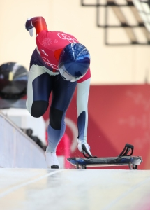A skeleton athlete sprints from the starting line during a training session. (Photo: Greg Kolz)