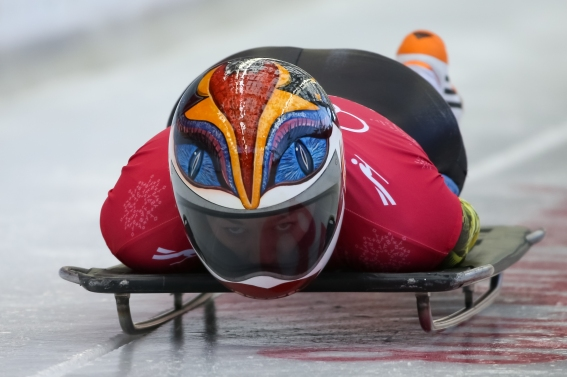 A slider keeps her eyes on the track during a skeleton training session. (Photo: Greg Kolz)