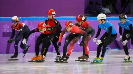 Pascal Dion receiving a push from teammate Samuel Girard during the Men's 5,000m heats. (Photo: Greg Kolz)