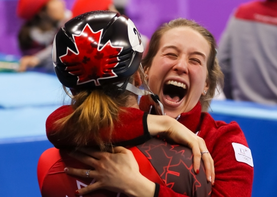 Kim Boutin receives a giant hug from teammate Marianne St-Gelais in celebration of Boutin's 3rd place finish in the Ladies' 500m Final. (Photo: Greg Kolz)