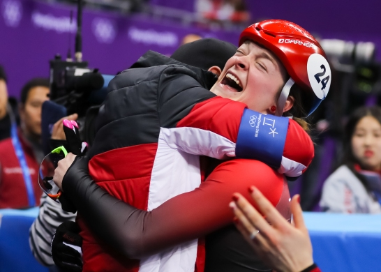 Kim Boutin celebrates her bronze medal in the Ladies' 500m Final with her coach Frederic Blackburn. (Photo: Greg Kolz)