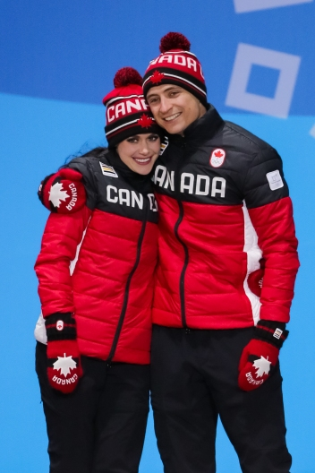 Tessa Virtue & Scott Moir share an embrace during the medal ceremony for the Team Event. (Photo: Greg Kolz)