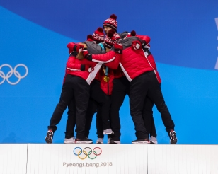 Canada's figure skaters celebrate a gold medal victory in the Team Event. (Photo: Greg Kolz)