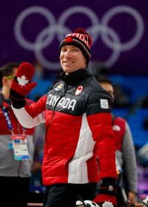 Canadian speed skater Ted-Jan Bloeman in the shadow of the Olympic Rings following the Men's 5,000m race.