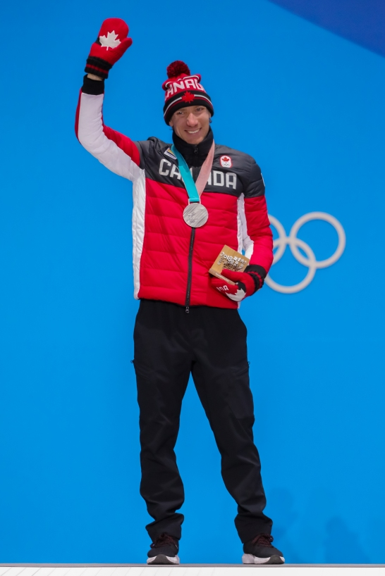 Jan-Ted Bloemen receives his Olympic silver medal for a 2nd place finish in the men's 5,000m speed skating event. (Photo: Greg Kolz)