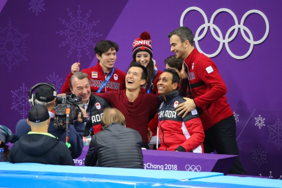 Members of Canada's figure skating team celebrate Patrick Chan's 1st place finish in the men's free skate. (Photo: Greg Kolz)