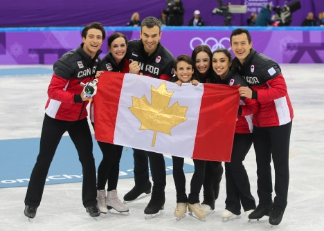 Canada's figure skaters celebrate their gold medal victory in the Team Event. (Photo: Greg Kolz)