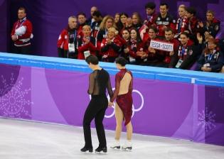 Canada's figure skaters cheer on Tessa Virtue & Scott Moir during the Team Event. (Photo: Greg Kolz)