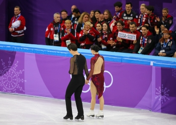 Canada's figure skaters cheer on Tessa Virtue & Scott Moir during the Team Event. (Photo: Greg Kolz)