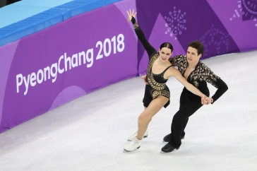Tessa Virtue & Scott Moir performing their Latin-themed short dance during the Figure Skating Team Event. (Photo: Greg Kolz)