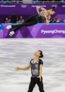 Ryom Tae Ok & Kim Ju Sik wowed the crowd with a charismatic performance in the Pair Skating competition. (Photo: Greg Kolz)