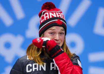 Kim Boutin wipes away tears during the Olympic Medal Ceremony for the Ladies' 500m event. (Photo: Greg Kolz)