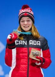 Kim Boutin displays her Olympic Bronze Medal. (Photo: Greg Kolz)