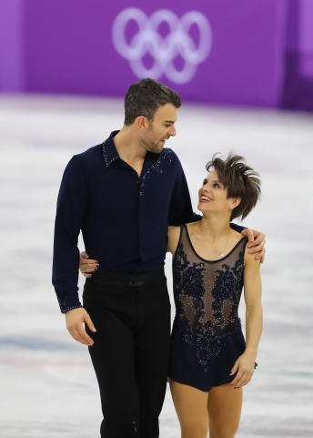 Meagan Duhamel & Eric Radford were visibly pleased with their performance. (Photo: Greg Kolz)