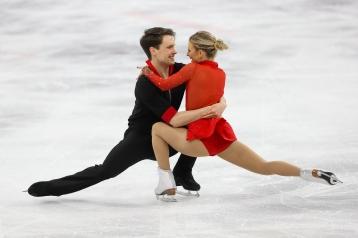 Kirsten Moore-Towers & Michael Marinaro performing their short program in the Pair Skating event. (Photo: Greg Kolz)