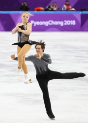 Julianne Seguin takes flight as Charlie Bilodeau throws her in the air during the Pair Skating competition. (Photo: Greg Kolz)