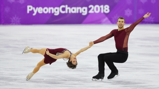 February 15, 2018: Meagan Duhamel & Eric Radford performing their free program which lead to a bronze medal in the pairs competition. (PHOTO: Greg Kolz)