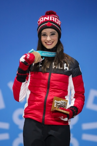 February 23, 2018: Kaetlyn Osmond shows off the Olympic bronze medal she earned in the ladies' figure skating competition. (PHOTO: Greg Kolz)