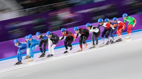 February 24, 2018: Speed skater Ivanie Blondin (#3) competing in the ladies' mass start event. (PHOTO: Greg Kolz)