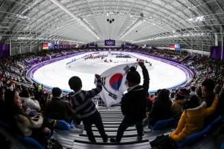 February 21, 2018: Young Korean speed skating fans cheer on their favourite athletes at the Gangneung Oval. (PHOTO: Greg Kolz)