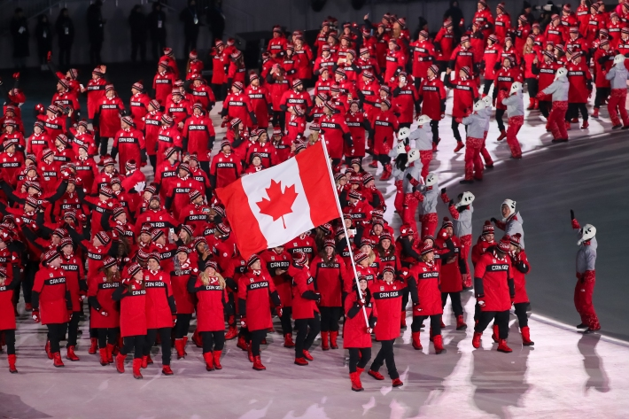 February 9, 2018: Flagbearers Tessa Virtue & Scott Moir lead Team Canada into PyeongChang Olympic Stadium during the Opening Ceremony. (PHOTO: Greg Kolz)