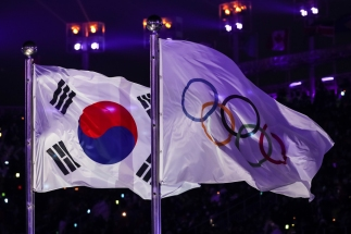 February 9, 2018: The Korean and Olympic flags flying side-by-side during the Opening Ceremony at PyeongChang Olympic Stadium. (PHOTO: Greg Kolz)