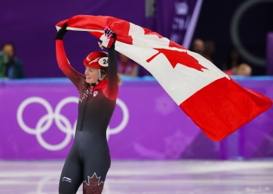 February 22, 2018: Short track speed skater Kim Boutin celebrates her silver medal result in the women's 1000m final. (PHOTO: Greg Kolz)