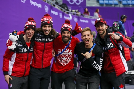 February 17, 2018: Short track teammates Charle Cournoyer, Samuel Girard, Charles Hamelin, Pascal Dion, and Francois Hamelin celebrate their bronze mdeal result in the men's 5000m relay. (PHOTO: Greg Kolz)