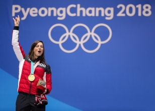 February 23, 2018: Kelsey Serwa celebrates her victory in women's ski cross during her Olympic medal ceremony. (PHOTO: Greg Kolz)