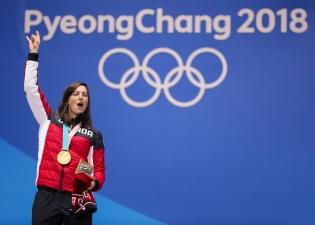 February 23, 2018: Kelsey Serwa celebrates her victory in women's ski cross during her Olympic medal ceremony. (PHOTO: Greg Kolz)
